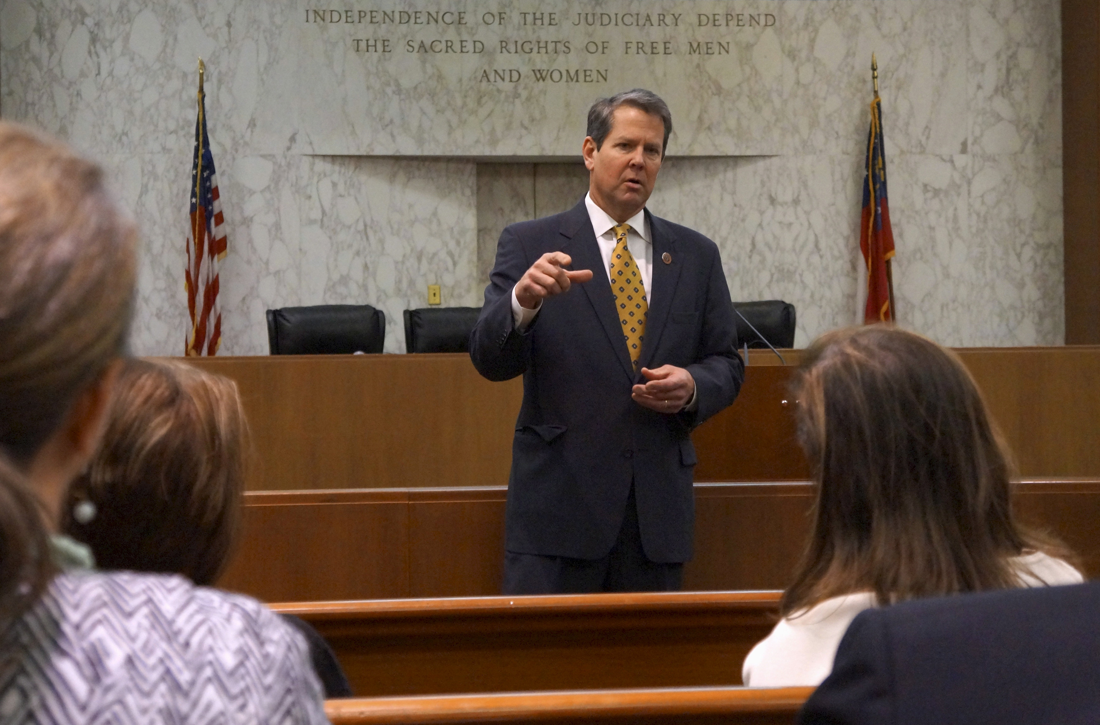 """FILE PHOTO: Georgia Secretary of State Brian Kemp speaks with visitors to the state capitol about the """"SEC primary"""" involving a group of southern states voting next month in Atlanta, Georgia February 24, 2016. REUTERS/Letitia Stein/File Photo"""