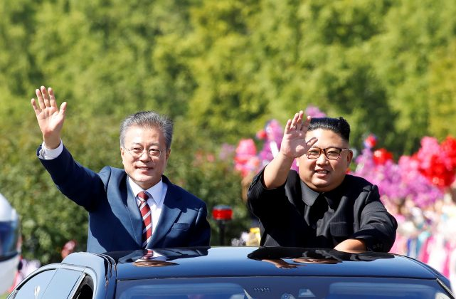South Korean President Moon Jae-in and North Korean leader Kim Jong Un wave during a car parade in Pyongyang, North Korea, September 18, 2018. Pyeongyang Press Corps/Pool via REUTERS