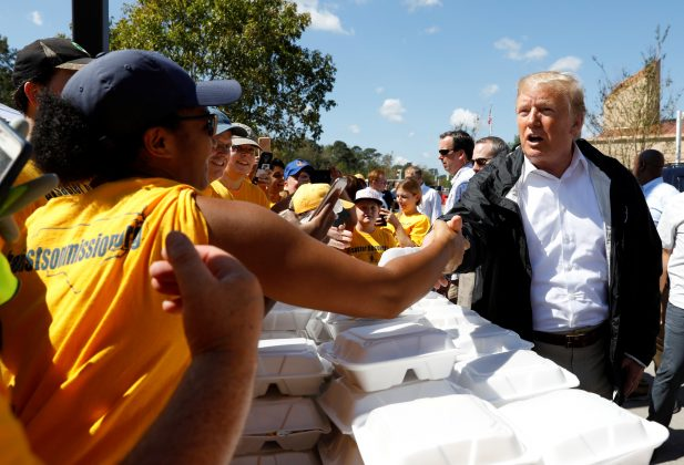 U.S. President Donald Trump greets people while distributing food after Hurricane Florence in New Bern North Carolina, U.S., September 19, 2018. REUTERS/Kevin Lamarque