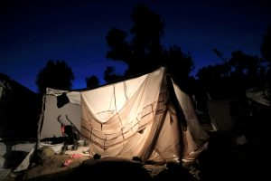 A tent is illuminated at a makeshift camp next to the Moria camp for refugees and migrants on the island of Lesbos, Greece, September 18, 2018. REUTERS/Giorgos Moutafis