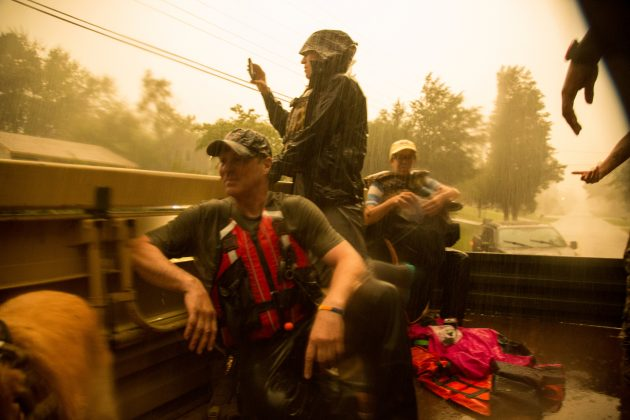 Emergency personnel and local media drive through flooded streets to assess the damage caused by Hurricane Florence, in Spring Lake, North Carolina, September 17, 2018. Spc. Austin T. Boucher/U.S. Army/Handout via REUTERS