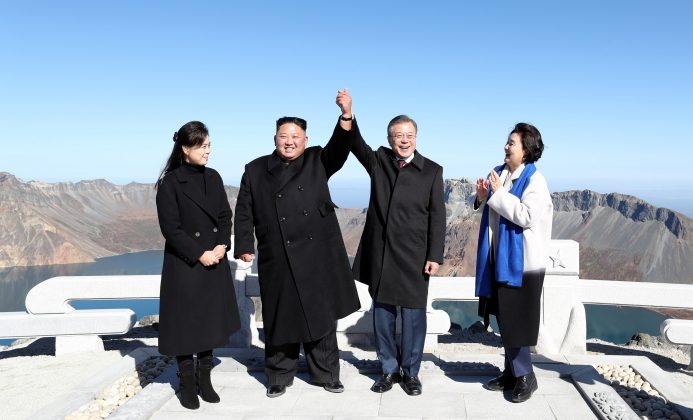 South Korean President Moon Jae-in and North Korean leader Kim Jong Un pose for photographs on the top of Mt. Paektu, North Korea September 20, 2018. Pyeongyang Press Corps/Pool via REUTERS