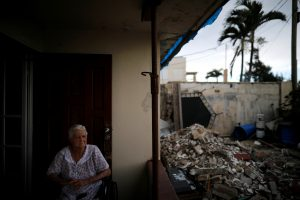 Lucila Cabrera, 86, sits at the porch of her damaged house by Hurricane Maria, a year after the storm devastated Puerto Rico, near Barceloneta, Puerto Rico, September 18, 2018. Picture taken September 18, 2018. REUTERS/Carlos Bar