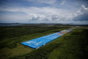 About 20,000 pallets of unused water bottles are seen along an airplane runway a year after Hurricane Maria devastated Puerto Rico in Ceiba, Puerto Rico, September 18, 2018. Picture taken September 18, 2018. REUTERS/Carlos Barria