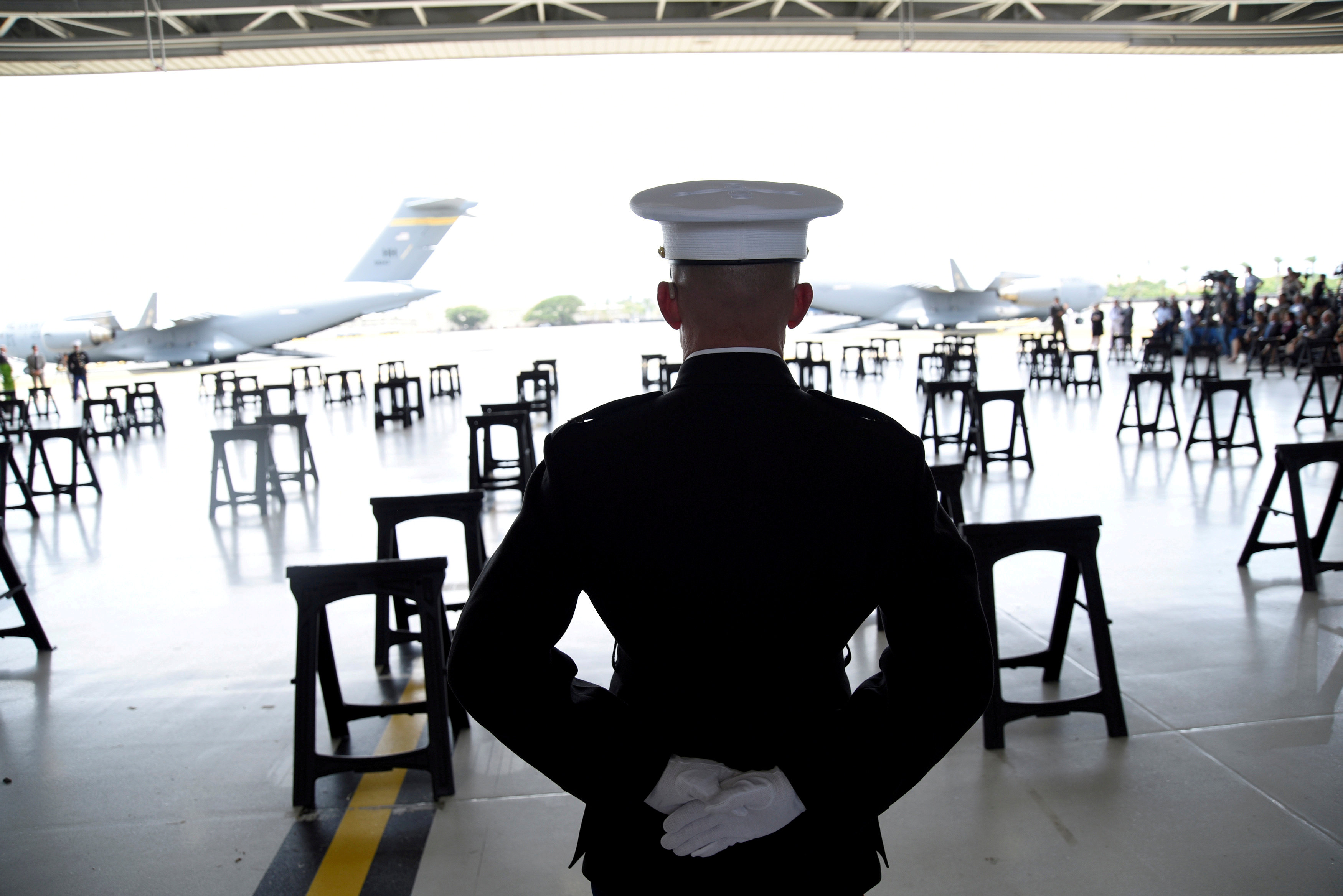 FILE PHOTO: A U.S. Marine stands as caskets containing the remains of American servicemen from the Korean War handed over by North Korea arrive at Joint Base Pearl Harbor-Hickam in Honolulu, Hawaii, Aug. 1, 2018. REUTERS/Hugh Gentry/File Photo