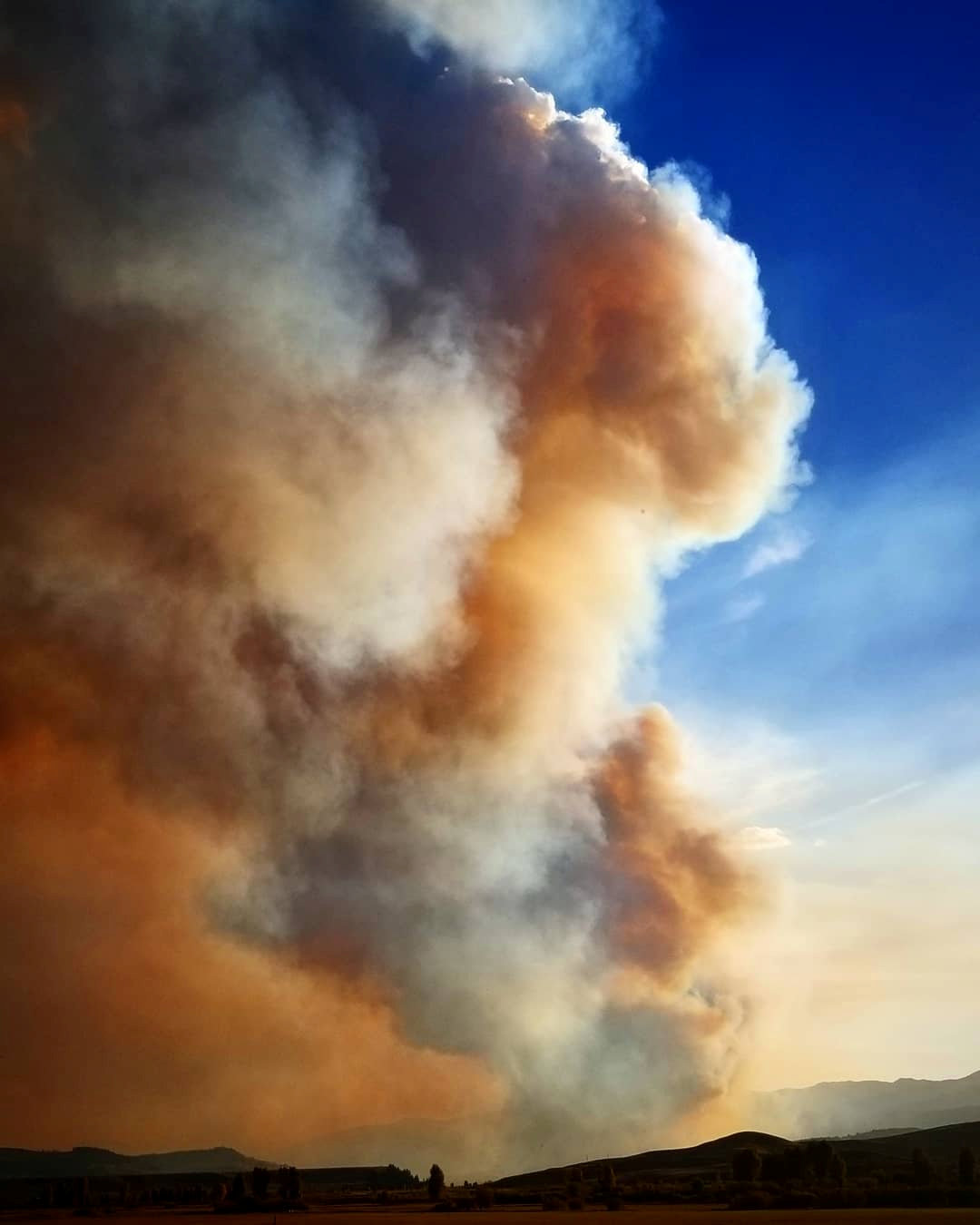 Smoke rises from a wildfire as seen from Bondurant, Wyoming, United States in this September 22, 2018 photo by Jared Kail. Jared Kail/Social Media/via REUTERS