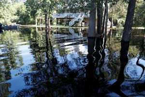 FILE PHOTO: Water from the flooded Waccamaw River surrounds a house in the aftermath of Hurricane Florence now downgraded to a tropical depression in Conway, South Carolina, U.S. September 19, 2018. REUTERS/Randall