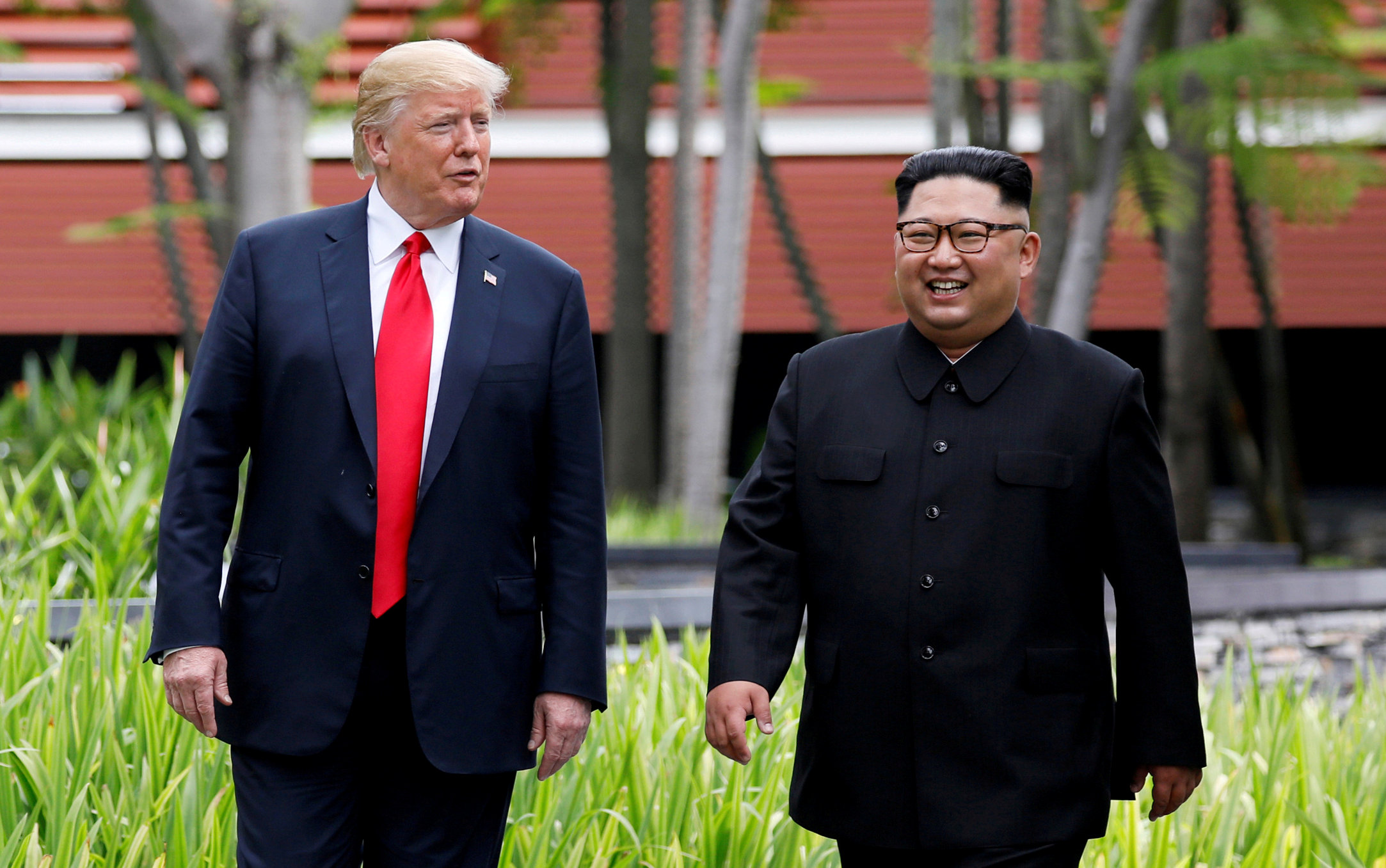 FILE PHOTO: U.S. President Donald Trump and North Korean leader Kim Jong Un walk after lunch at the Capella Hotel on Sentosa island in Singapore June 12, 2018. REUTERS/Jonathan Ernst/File Photo