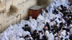 Jewish worshippers, some covered in prayer shawls, pray during a priestly blessing on the Jewish holiday of Sukkot at the Western Wall in Jerusalem's Old City September 26, 2018. REUTERS/Ammar Awad