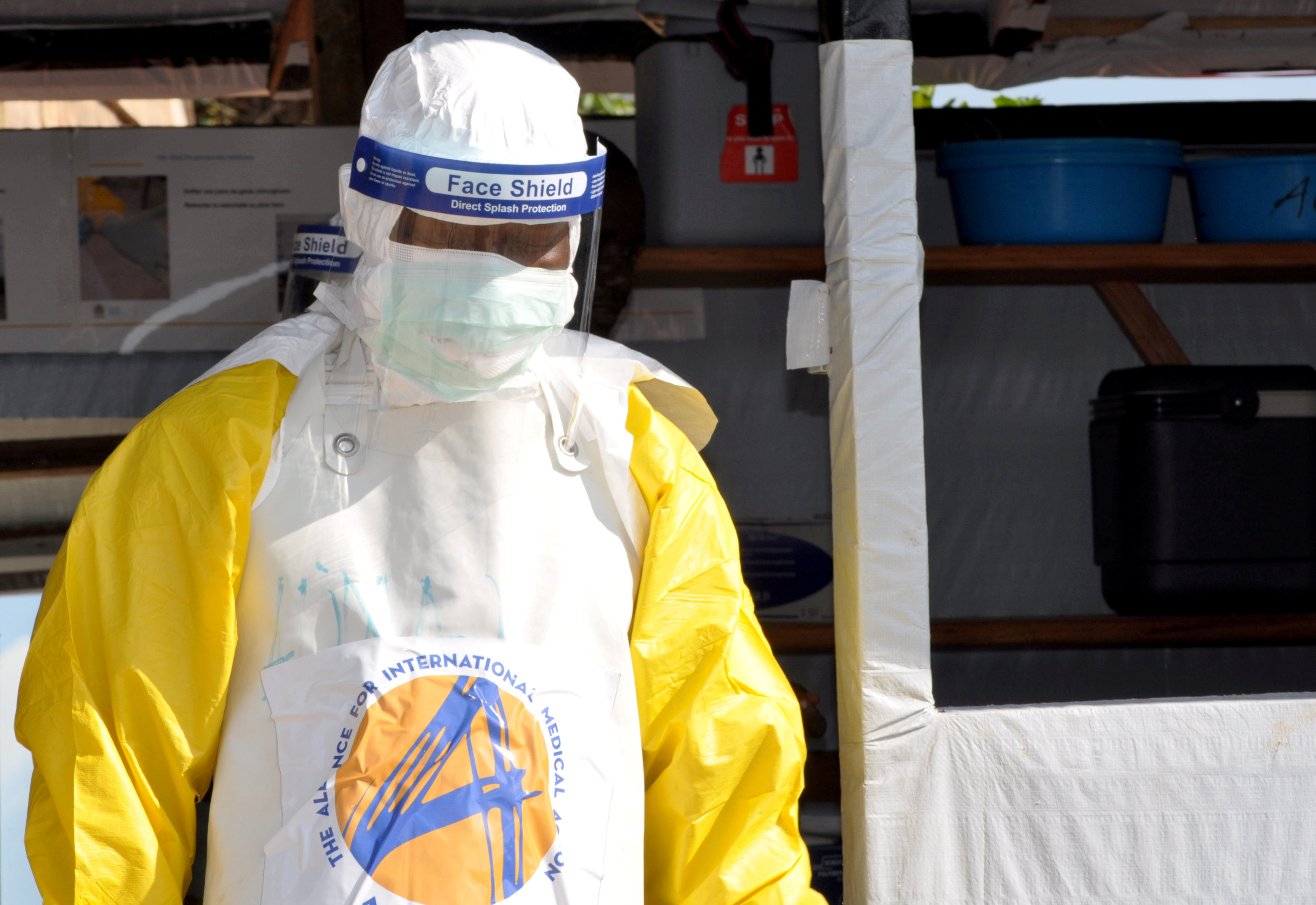 FILE PHOTO: A medical worker wears a protective suit as he prepares to administer Ebola patient care at The Alliance for International Medical Action (ALIMA) treatment center in Beni, North Kivu province of the Democratic Republic of Congo September 6, 2018. REUTERS/Fiston Mahamba/File Photo