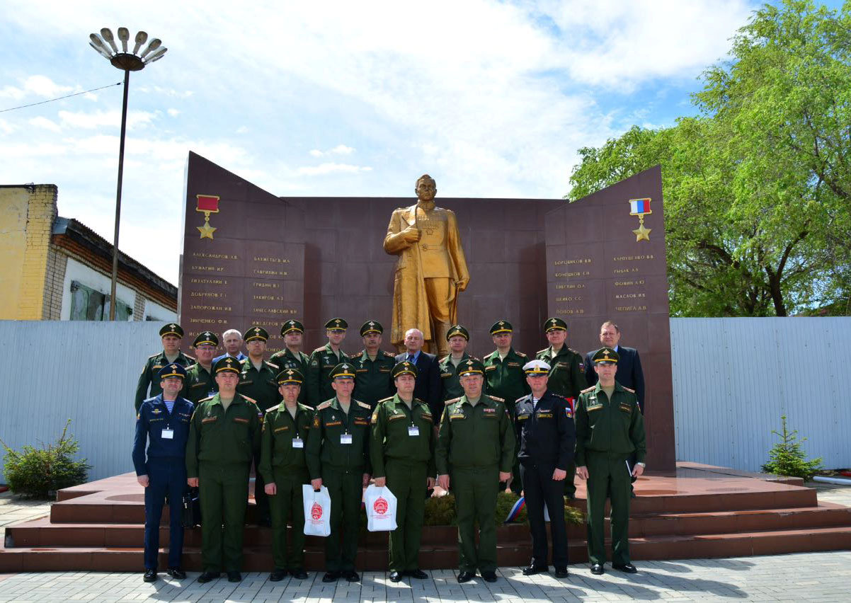 Russian military representatives pose in front of the memorial wall with Anatoliy Chepiga as the last name under the Gold Star honor list at the Far-Eastern Military Command Academy in Blagoveshensk, Russia May 24, 2017. Russian Defence Ministry/Handout via REUTERS