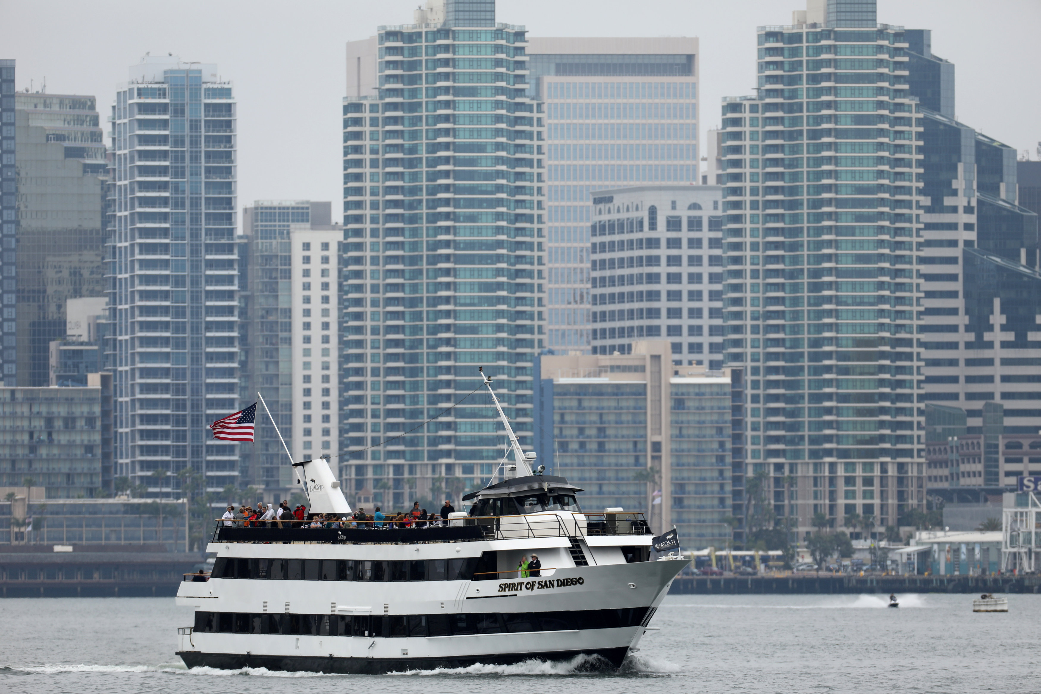 FILE PHOTO: A tourist sightseeing boat motors through San Diego harbor in San Diego, California, U.S., June 5, 2017. REUTERS/Mike Blake/File Photo
