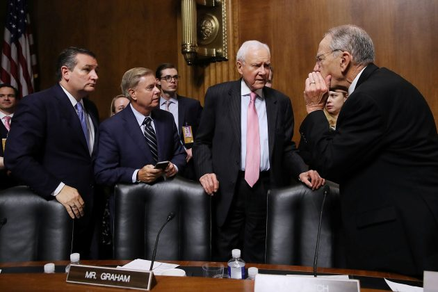 Senate Judiciary Committee members (L-R) Sen. Ted Cruz (R-TX), Sen. Lindsey Graham (R-SC), Sen. Orrin Hatch (R-UT) and Chairman Charles Grassley (R-IA) talk at the conclusion of the Supreme Court confirmation hearing for Judge Brett Kavanaugh in the Dirksen Senate Office Building on Capitol Hill in Washington, DC, U.S., September 27, 2018. Win McNamee/Pool via REUTERS