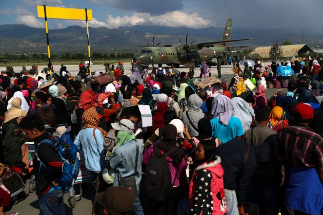 Local residents affected by the earthquake and tsunami wait to be airlifted out by a military plane at Mutiara Sis Al Jufri Airport in Palu, Central Sulawesi, Indonesia, October 1, 2018. REUTERS/Athit Perawongmetha