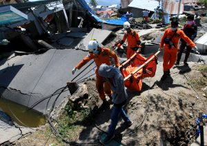 Indonesian rescue workers evacuate the body of a victim of an earthquake in Petabo, South Palu, Central Sulawesi, Indonesia, October 1, 2018, in this photo taken by Antara Foto. Antara Foto/Akbar Tado via REUTERS