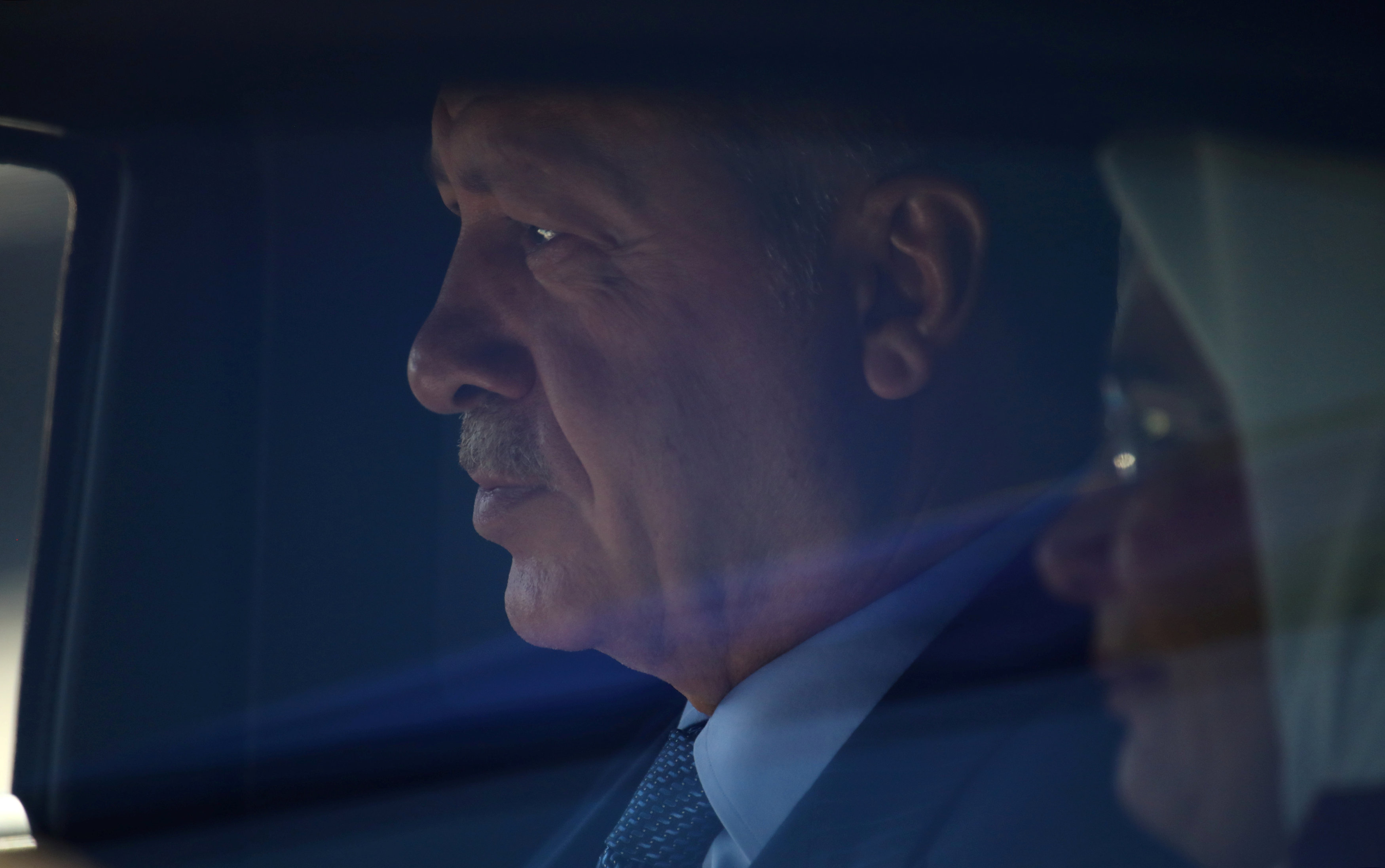 FILE PHOTO: Turkish President Tayyip Erdogan with his wife Emine are seen in a car as they arrive in Berlin, Germany, September 27, 2018. REUTERS/Hannibal Hanschke/File Photo