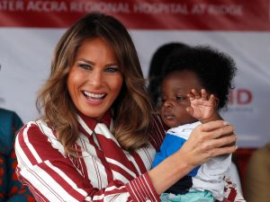 U.S. first lady Melania Trump holds a child during a visit to a hospital in Accra, Ghana. REUTERS/Carlo Allegri