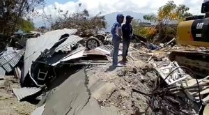 Debris and damaged property are seen following an earthquake in Petobo, Central Sulawesi, Indonesia, October 3, 2018, in this still image obtained from a social media video. Palang Merah Indonesia (Red Cross)/via REUTERS.