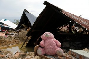 A soft toy is seen among the ruins of a house after an earthquake hit the Balaroa sub-district in Palu, Indonesia, October 4, 2018. REUTERS/Beawiharta