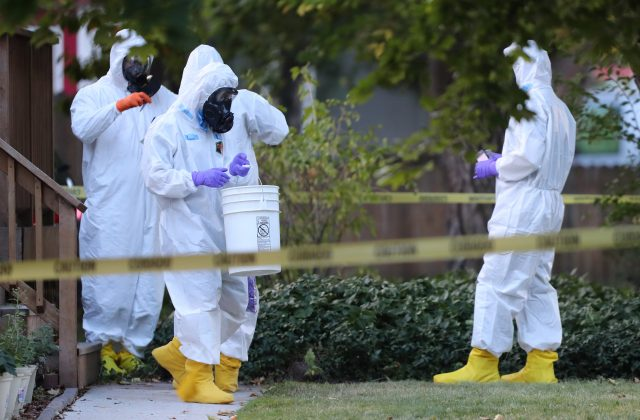 "FBI and law enforcement officers in hazmat suites prepare to enter a house, which FBI says was investigating ""potentially hazardous chemicals"" in Logan, Utah, U.S., October 3, 2018. REUTERS/George Frey"