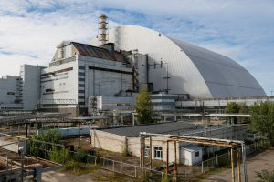 A new Safe Confinement arch covering the damaged fourth reactor of the Chernobyl nuclear power plant is seen near a newly built solar power plant in Chernobyl, Ukraine October 5, 2018. REUTERS/Gleb Garanich