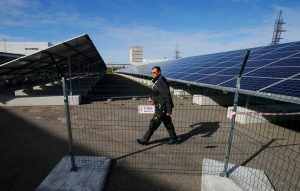 An employee walks past solar panels at a solar power plant built on the site of the world's worst nuclear disaster, Chernobyl, Ukraine October 5, 2015. REUTERS/Gleb Garanich