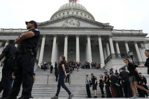 U.S. Capitol Police arrest protesters from the steps of the Capitol in the hours ahead of a scheduled U.S. Senate vote on the confirmation of Supreme Court nominee Judge Brett Kavanaugh in Washington, U.S. October 6, 2018. REUTERS/Jonathan Ernst