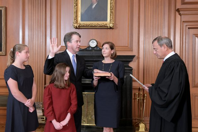 Judge Brett Kavanaugh is sworn in as an Associate Justice of the U.S. Supreme Court by Chief Justice John Roberts as Kavanaugh's wife Ashley holds the family bible and his daughters Liza and Margaret look on in a handout photo provided by the U.S. Supreme Court taken at the Supreme Court building in Washington, U.S., October 6, 2018. Fred Schilling/Collection of the Supreme Court of the United States/Handout via Reuters
