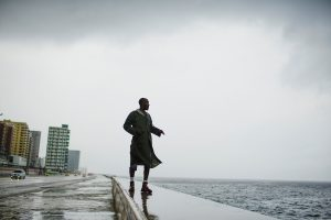 Alexander Charnicharo fishes at the seafront in Havana as Hurricane Michael passes by western Cuba on October 8, 2018. REUTERS/Alexandre Meneghini