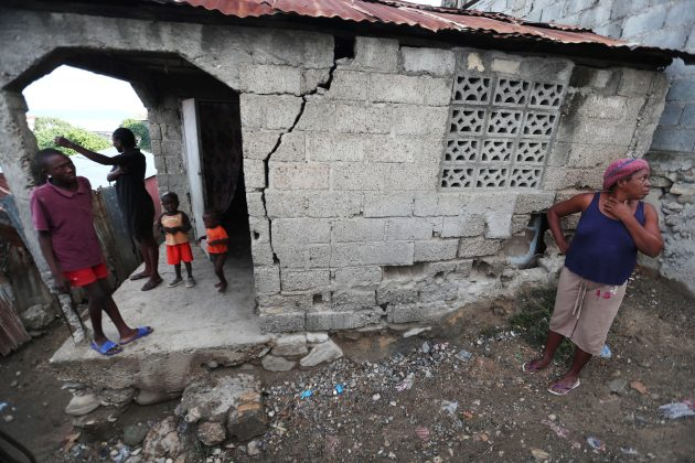 People stand outside their home after it was damaged in an earthquake, that hit northern Haiti late on Saturday, in Port-de-Paix, Haiti, October 8, 2018. REUTERS/Ricardo Rojas