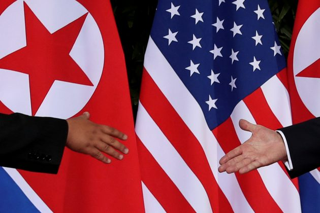 FILE PHOTO: U.S. President Donald Trump and North Korea's leader Kim Jong Un meet at the start of their summit at the Capella Hotel on the resort island of Sentosa, Singapore June 12, 2018. REUTERS/Jonathan Ernst/File Photo