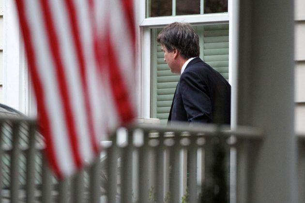 Newly confirmed and sworn-in U.S. Supreme Court Associate Justice Brett Kavanaugh heads off to his first day of work as a justice at the Supreme Court as he leaves his house in Chevy Chase, Maryland, U.S., October 9, 2018. REUTERS/Joshua Roberts