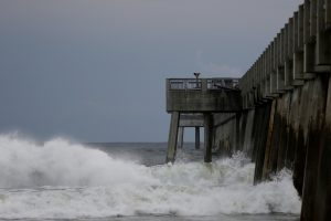 Waves crash along a pier as Hurricane Michael approaches Panama City Beach, Florida, U.S. October 9, 2018. REUTERS/Jonathan Bachman