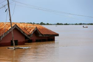FILE PHOTO: A house partially submerged in flood waters is pictured in Lokoja city, Kogi State, Nigeria September 17, 2018. REUTERS/Afolabi Sotunde/File Photo