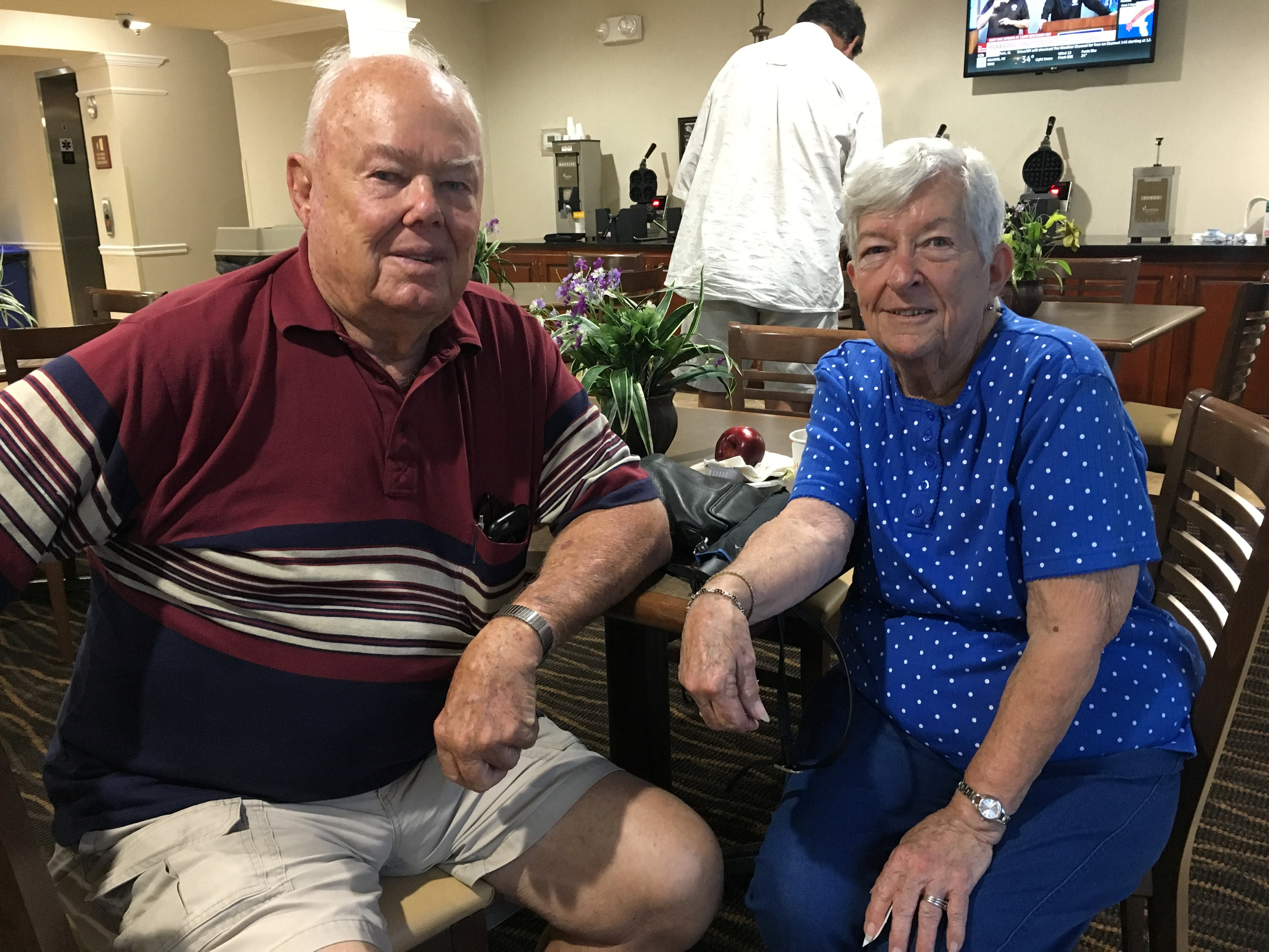 JW and Helen Neal sit in a hotel one mile from their beachfront house due to Hurricane Michael, in Panama City, Florida, U.S., October 10, 2018. REUTERS/Rod Nickel