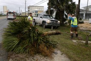 Emergency crews work to clear a street of debris during Hurricane Michael in Panama City Beach, Florida, U.S. October 10, 2018. REUTERS/Jonathan Bachman