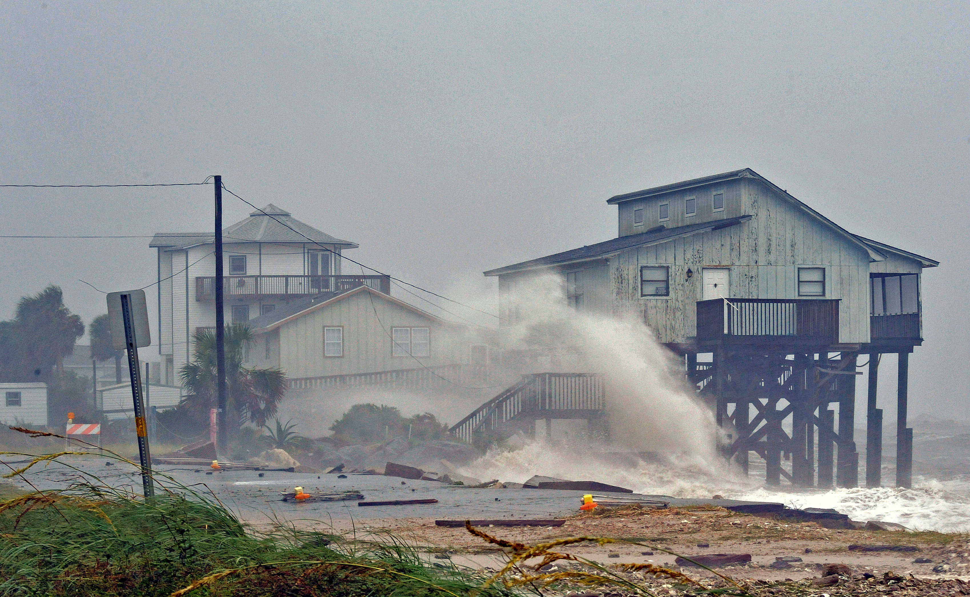 Waves crash on stilt houses along the shore due to Hurricane Michael at Alligator Point in Franklin County, Florida, U.S., October 10, 2018. REUTERS/Steve Nesius