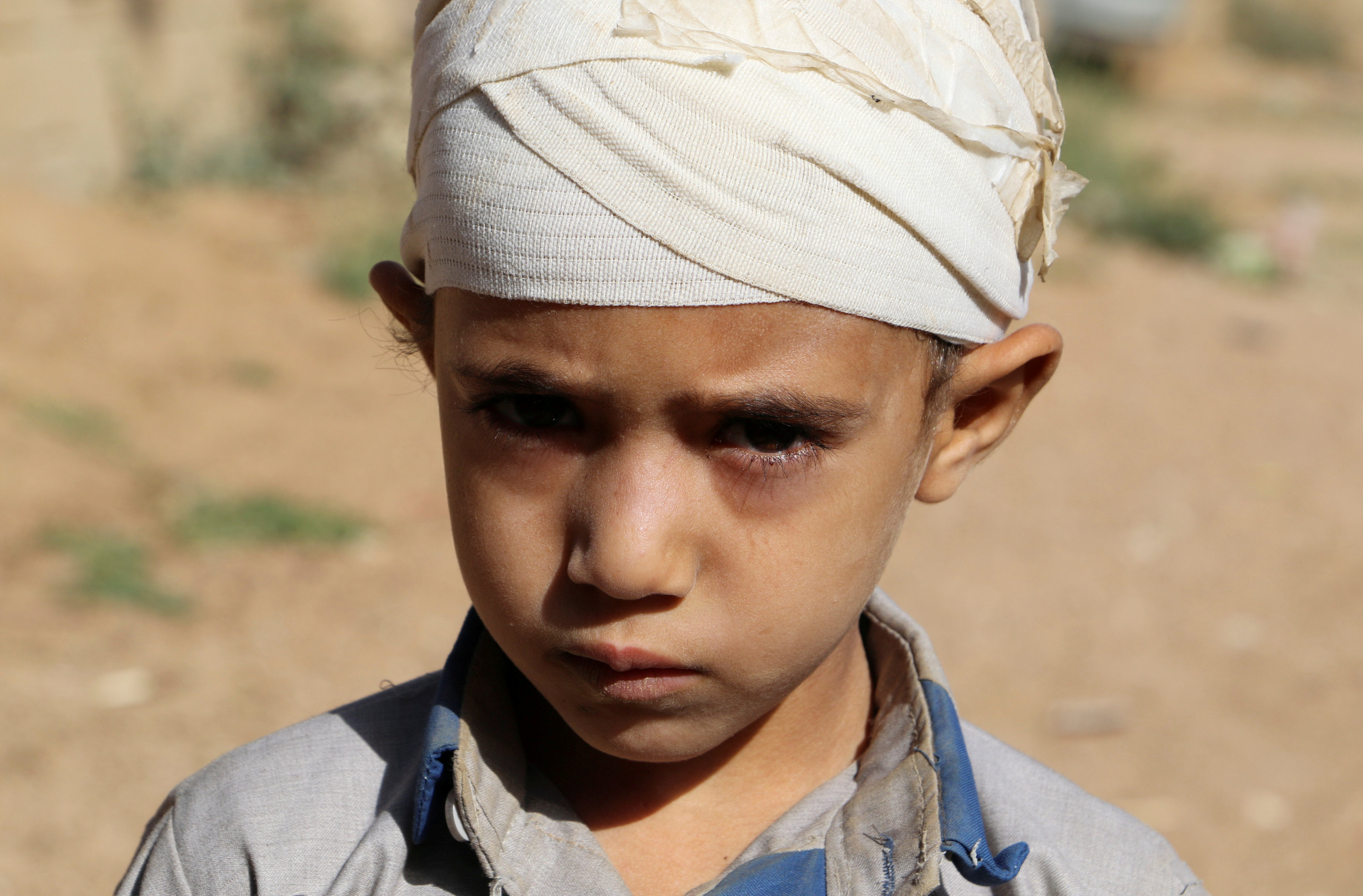 FILE PHOTO: Mukhtar Hadi, who survived a Saudi-led air strike that killed dozens including children, stands outside his house in Saada, Yemen September 4, 2018. Picture taken September 4, 2018. REUTERS/Naif Rahma/File Photo