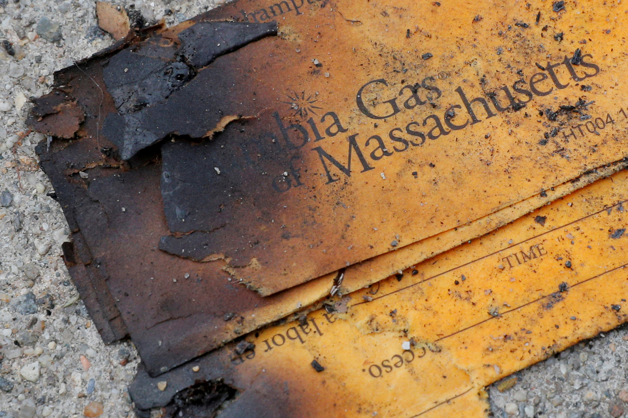 FILE PHOTO: A burnt Columbia Gas of Massachusetts envelope sits on the sidewalk outside a home burned during a series of gas explosions in Lawrence, Massachusetts, U.S., September 14, 2018. REUTERS/Brian Snyder/File Photo