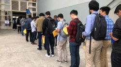 Students wait in line to enter the University of California, Berkeley's electrical engineering and computer sciences career fair in Berkeley, California, in September. REUTERS/Ann Saphir