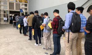 Students wait in line to enter the University of California, Berkeley's electrical engineering and computer sciences career fair in Berkeley, California, in September. REUTERS/Ann Saphir