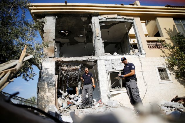 Israeli sappers work on a house that the Israeli military said was hit by a rocket fired from the Gaza Strip, in Beersheba, southern Israel October 17, 2018. REUTERS/Amir Cohen