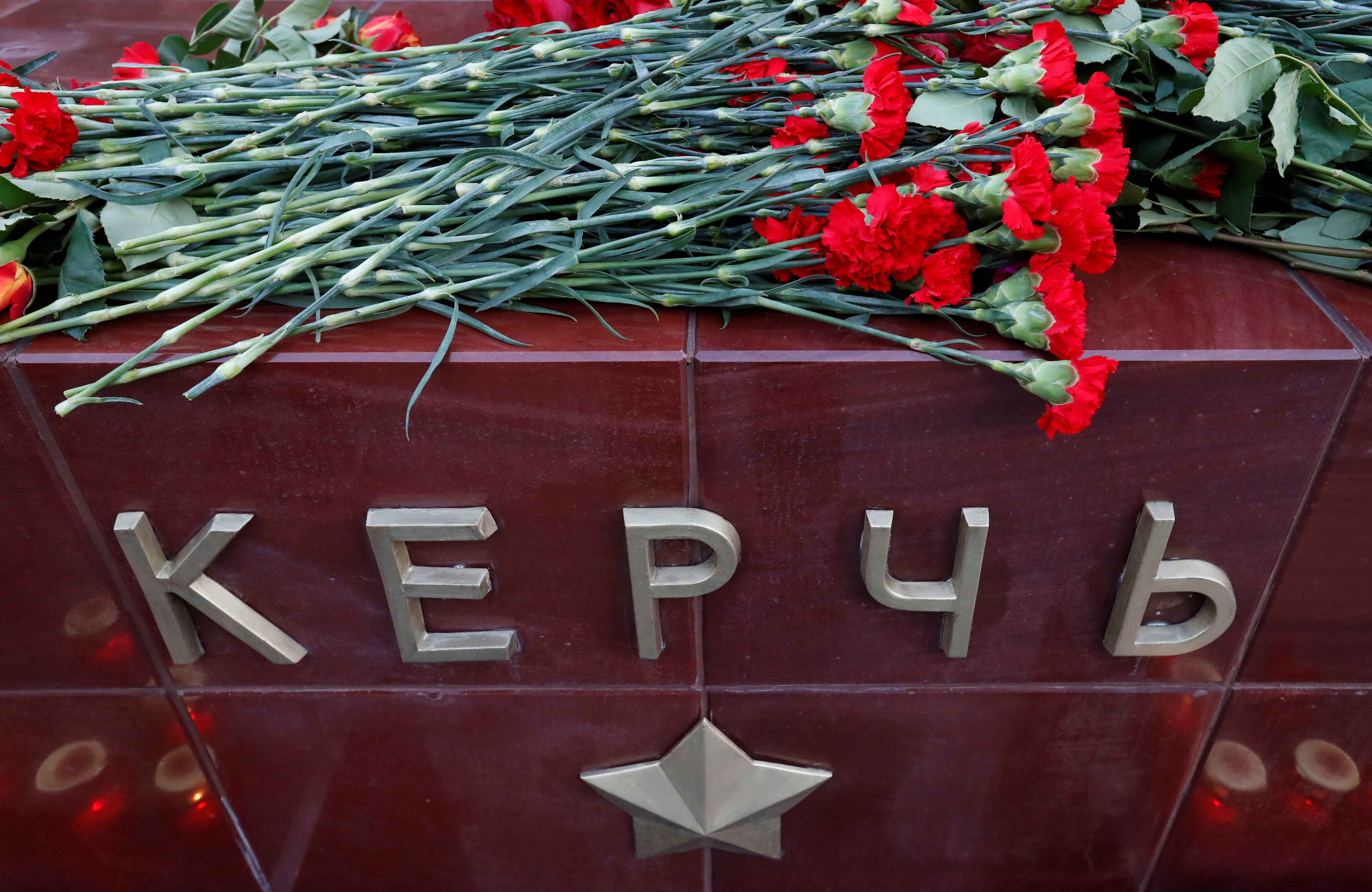 Flowers are seen placed at a memorial by the Kremlin walls to commemorate the victims of a fatal attack on a college in the Crimean port city of Kerch, in Moscow, Russia October 17, 2018. REUTERS/Sergei Karpukhin