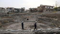 FILE PHOTO: Members of the Civil Defence, also known as the 'White Helmets', are seen inspecting the damage at a Roman ruin site in Daraa, Syria December 23, 2017. REUTERS/Alaa al-Faqir/File Photo