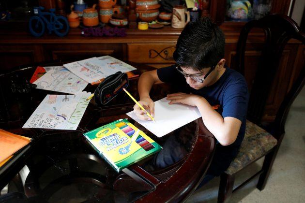 Gabriel Moncada draws at his home in Caracas, Venezuela October 15, 2018. Picture taken October 15, 2018. REUTERS/Marco Bello