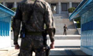 FILE PHOTO: A North Korean soldier patrols at the truce village of Panmunjom inside the demilitarized zone (DMZ) separating the two Koreas, South Korea, April 18, 2018. Picture taken on April 18, 2018. REUTERS/Kim Hong-Ji