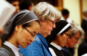 FILE PHOTO: Sister Sally Hodgdon (2nd L) stands during a synod afternoon session led by Pope Francis at the Vatican October 16, 2018. Picture taken October 16, 2018. REUTERS/Max Rossi