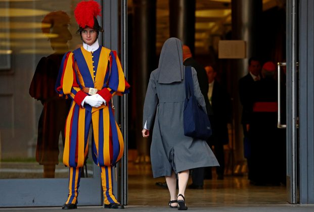 FILE PHOTO: A nun enters to take part at the synod afternoon session led by Pope Francis at the Vatican October 16, 2018. Picture taken October 16, 2018. REUTERS/Max Rossi