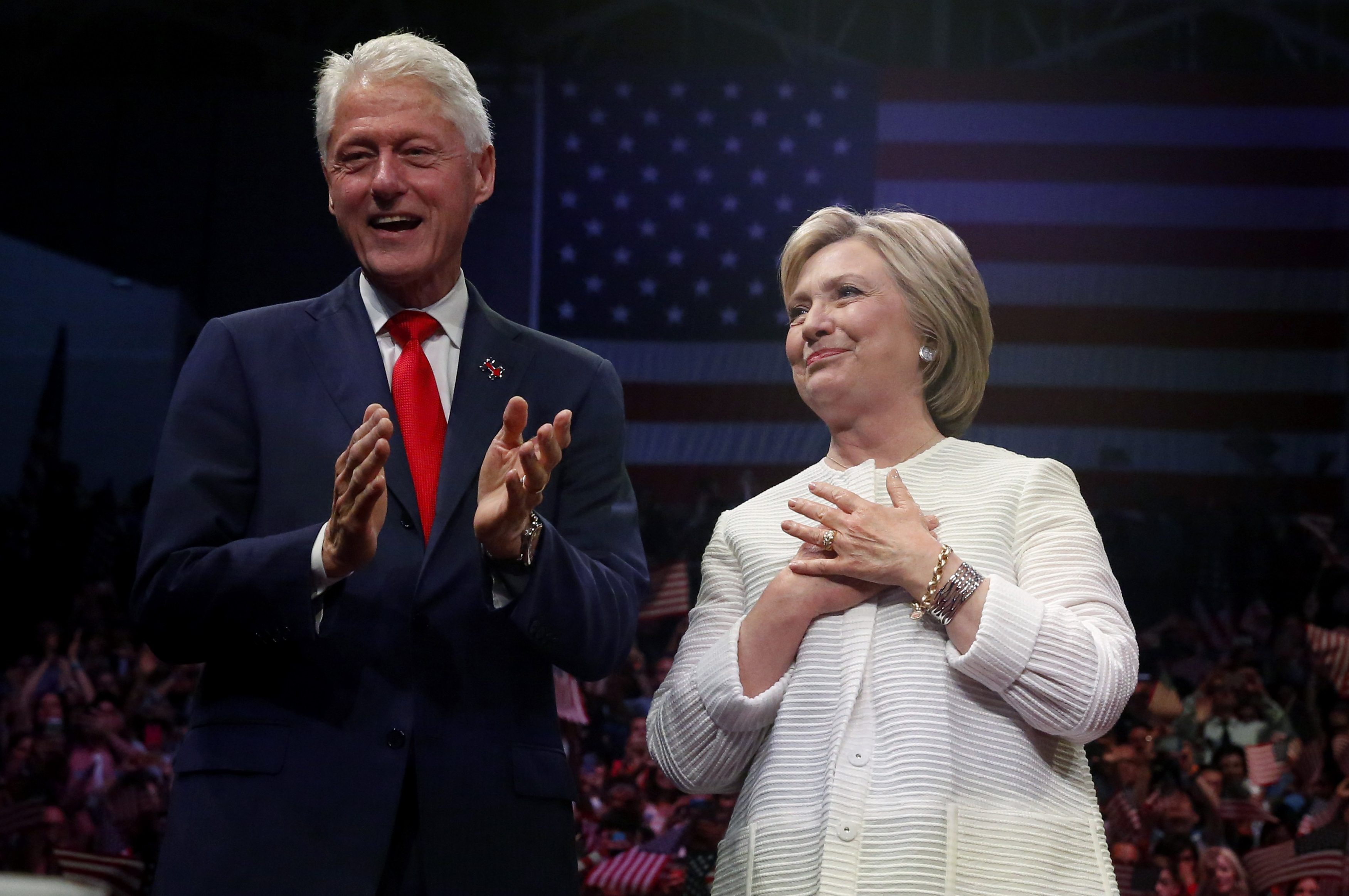 Democratic U.S. presidential candidate Hillary Clinton stands onstage with her husband former President Bill Clinton (L) after speaking during her California primary night rally held in the Brooklyn borough of New York, U.S., June 7, 2016. REUTERS/Shannon Stapleton