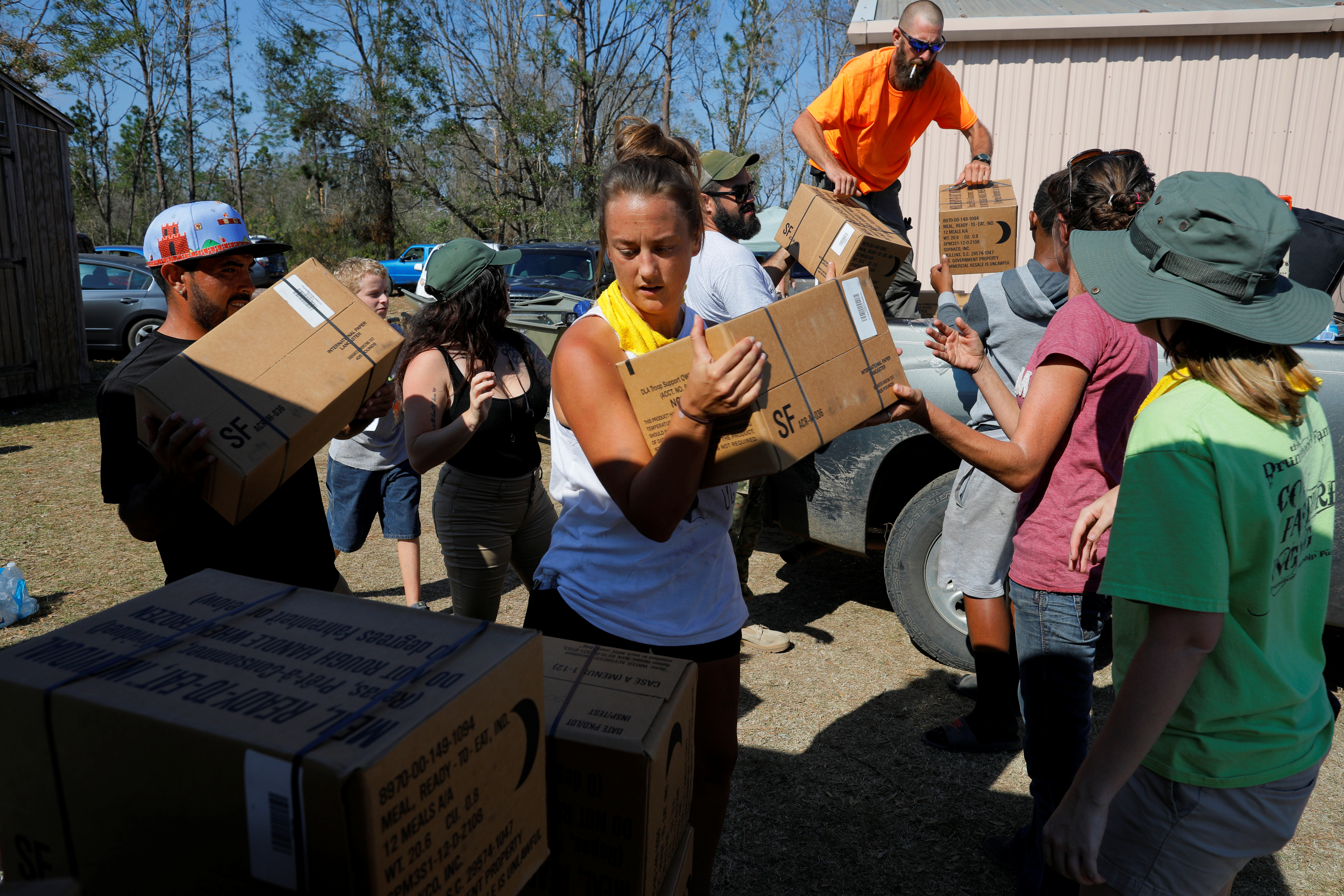 50 Star Search and Rescue team members and volunteers unload a pallet of MREs (Meal, Ready-to-Eat) at a relief center at Fountain's Victory Tabernacle church in Fountain, Florida, U.S., October 18, 2018. REUTERS/Brian Snyder